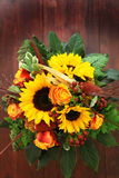 Bouquet of flowers of a large sunflower top Royalty Free Stock Photography