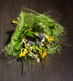 Bouquet of flowers lying on the floor Royalty Free Stock Images