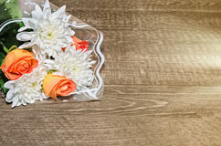 Flowers lie on wooden background Stock Photography