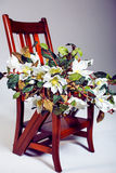 Bouquet of flowers lying on wooden chair Royalty Free Stock Photo