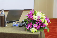 Bouquet of flowers with microphone to set table - banquet Stock Photography