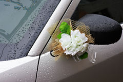Bouquet of flowers on the mirror wedding car Stock Photos