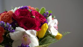 Bouquet of flowers moves around, different flowers, roses, tulips, violets. Bouquet of flowers moves around, different flowers, roses, tulips violets stock video