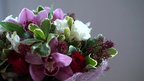 Bouquet of flowers moves around, different flowers, roses, tulips, violets. Bouquet of flowers moves around, different flowers, roses, tulips violets stock video footage