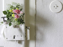 Bouquet of flowers on an old European door. Stock Photo