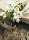 Bouquet of flowers on the opened book. Copy space Stock Photo