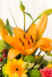 Bouquet of flowers with an orange lily Stock Image