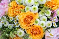 Bouquet of flowers; orange roses, chamomile, eustoma. Royalty Free Stock Image
