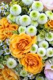 Bouquet of flowers; orange roses, chamomile, eustoma. Stock Photography
