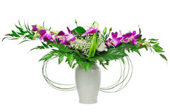 Bouquet of flowers with orchids in a vase Royalty Free Stock Image