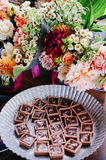 Bouquet of Flowers by Pastry Plate Stock Photos