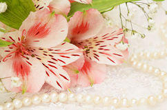 Bouquet of flowers and pearls Stock Photography