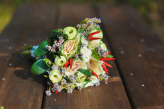 Bouquet of flowers and pepper Stock Images