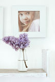 Bouquet of flowers and photo frame Royalty Free Stock Photos
