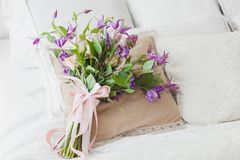 Bouquet of flowers. Bouquet of flowers on the pillow on the bed Stock Image