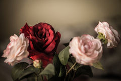 Bouquet of flowers, pink and red fabric roses on a dark background Royalty Free Stock Photography