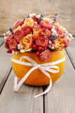 Bouquet of flowers in pumpkin Royalty Free Stock Photo