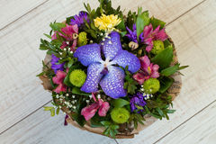 Bouquet of flowers Purple orchid, alstroemeria, green chrysanthemum, gypsophila and buxus Royalty Free Stock Image