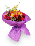 Bouquet of flowers in purple paper Stock Images