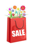 Bouquet of flowers in the red  shopping bag Stock Images