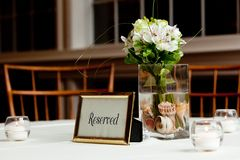 Bouquet of flowers on a reserved table Royalty Free Stock Photography