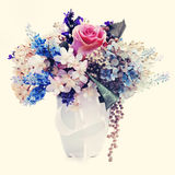 Bouquet from flowers with retro filter effect. Royalty Free Stock Photo