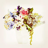 Bouquet from flowers with retro filter effect. Stock Photos
