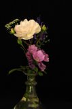 A bouquet of flowers. With rose on a black background Stock Photography