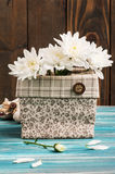 Bouquet of flowers in rough linen bag Stock Photography