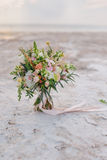 A bouquet of flowers on the salt crystals Royalty Free Stock Photo