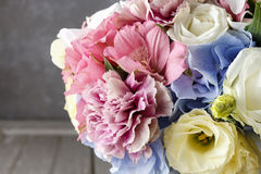 Bouquet of flowers in silver watering can Royalty Free Stock Photos