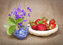 Bouquet of flowers and strawberries Stock Images