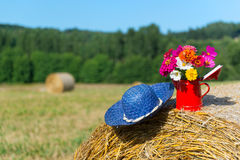 Bouquet flowers and summer hat in summer Stock Photography