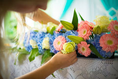 Bouquet of  flowers on the table. Florist making wedding flower decoration Stock Photo