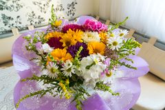 Bouquet of flowers on table in the room royalty free stock image