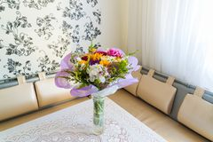 Bouquet of flowers on table in the room royalty free stock images