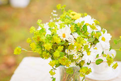 Bouquet of flowers on the table with white tablecloth Stock Photo