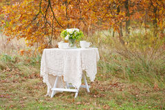 Bouquet of flowers on the table with white tablecloth Royalty Free Stock Photos