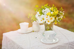 Bouquet of flowers on the table with white tablecloth Royalty Free Stock Image
