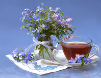 Bouquet of  flowers   and tea Stock Images