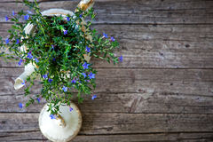 Bouquet of Flowers in Tea Pot on Wooden Planks Stock Photography