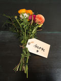 Bouquet of flowers and a text message I love mom Royalty Free Stock Photo