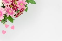 Bouquet of flowers top view with space for text with pink hearts royalty free stock image