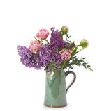 Bouquet of flowers of tulips and lilac in a ceramic jug. Royalty Free Stock Images
