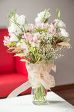 Bouquet of flowers in vase on table Stock Photography
