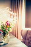 Bouquet of Flowers in Vase on a table by the window, cozy home. Interior royalty free stock photos