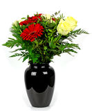 Bouquet of flowers in a vase on a white background Royalty Free Stock Photos