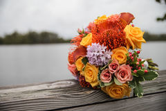 Bouquet of flowers by water Stock Image