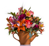 Bouquet of flowers in watering can Royalty Free Stock Photo