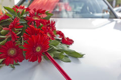 Bouquet of flowers on wedding car. Bouquet of red flowers on wedding car Stock Photos